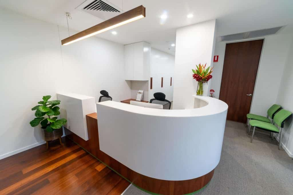 Contoured reception desk for easy cleaning
