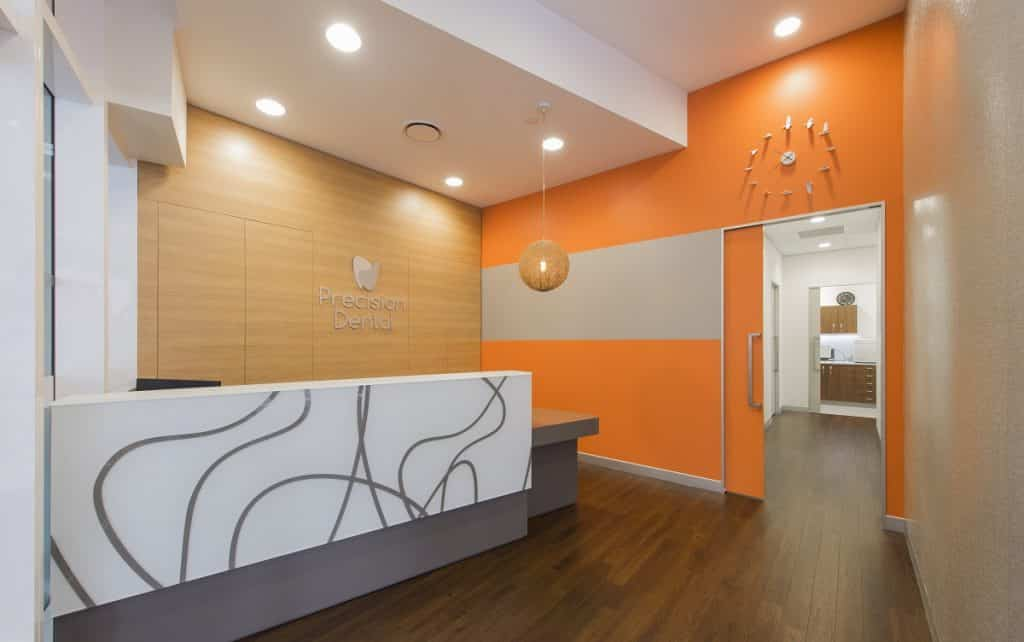 A bright orange colour features throughout the Precision Dental clinic