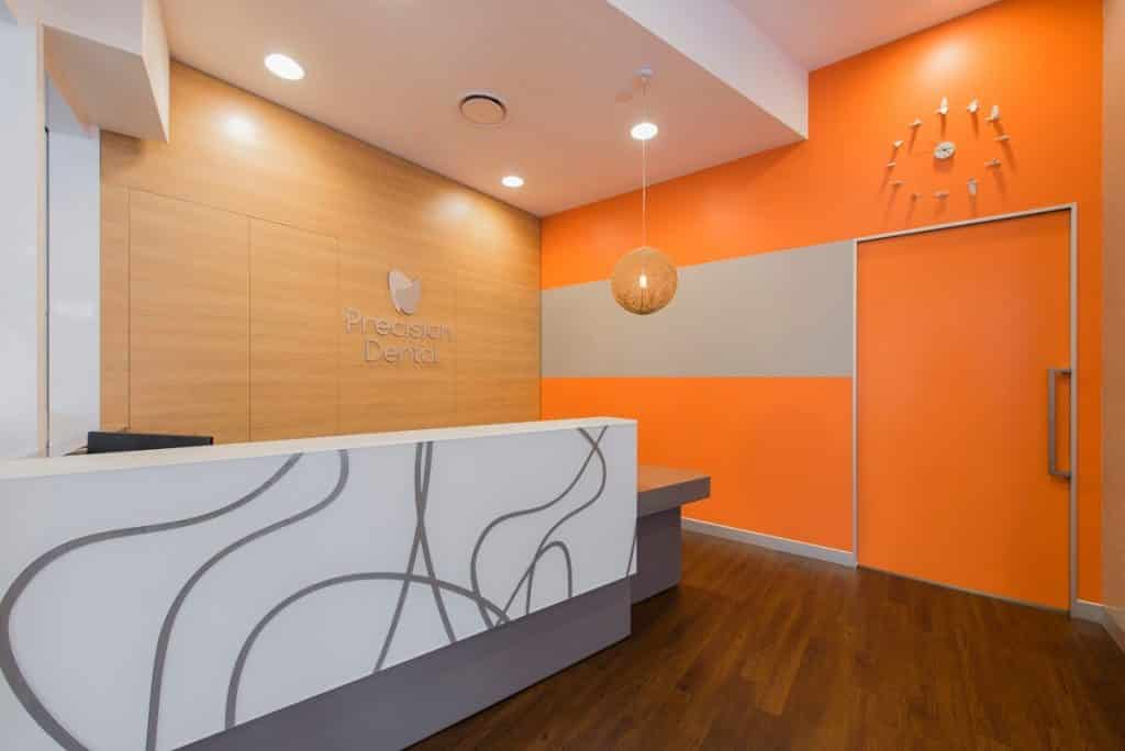 Bright orange paint features in this dental practice