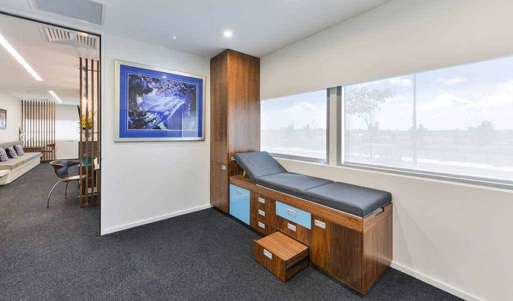 Orthopaedic specialist suite fitout showing consult room and reception area