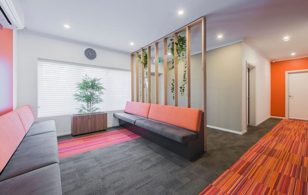 Medical practice reception with a room divider
